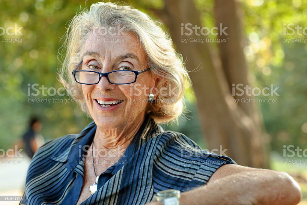Beautiful Senior Woman sitting in the park royalty-free stock photo