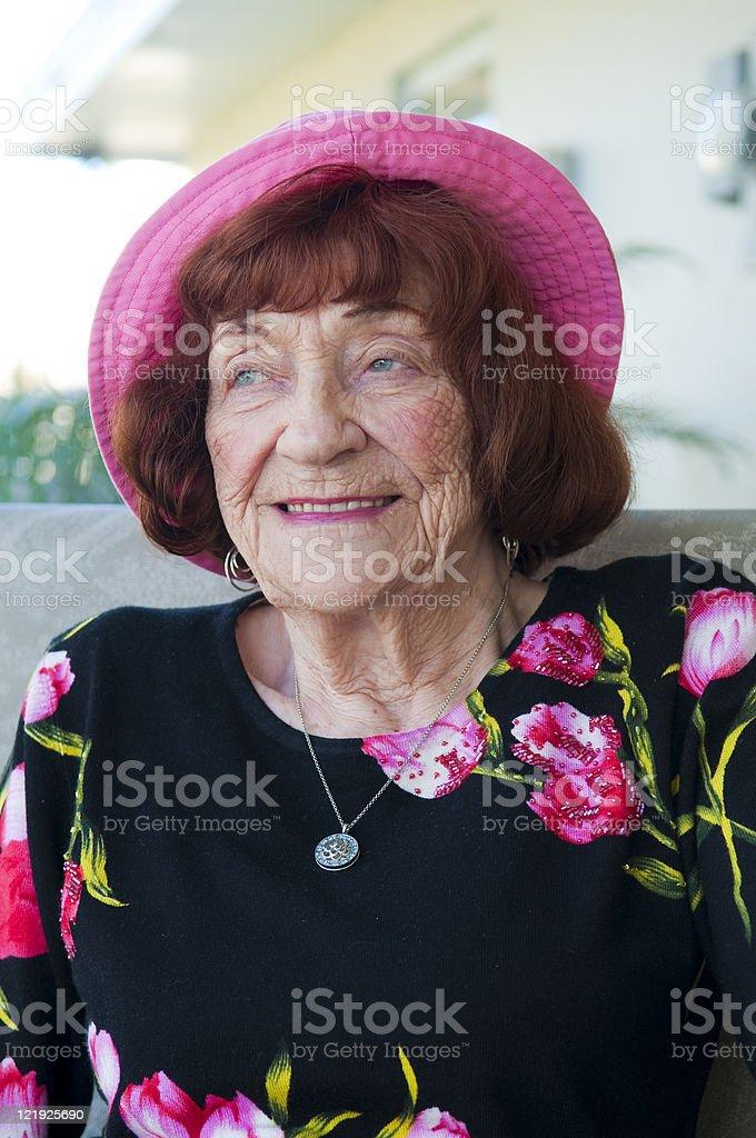 Beautiful senior woman sitting on patio of Florida home royalty-free stock photo