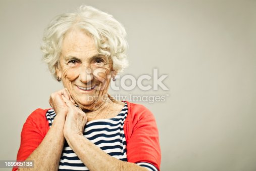 istock Beautiful senior woman smiling at camera 169965138