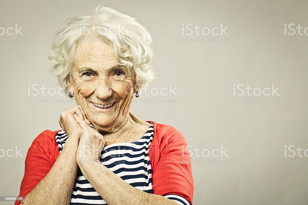 Beautiful senior woman smiling at camera stock photo