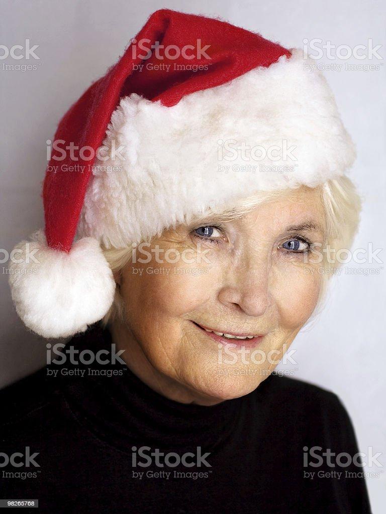 Beautiful senior woman wearing santa hat royalty-free stock photo