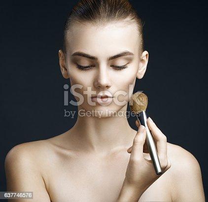 istock Beautiful sensual woman applying make-up. Perfect makeup. Beauty 637746576