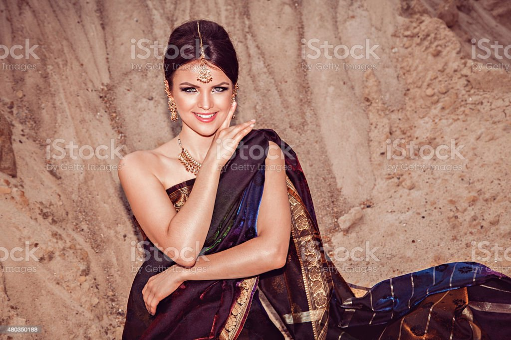 Beautiful sensual woman in traditional indian dress stock photo