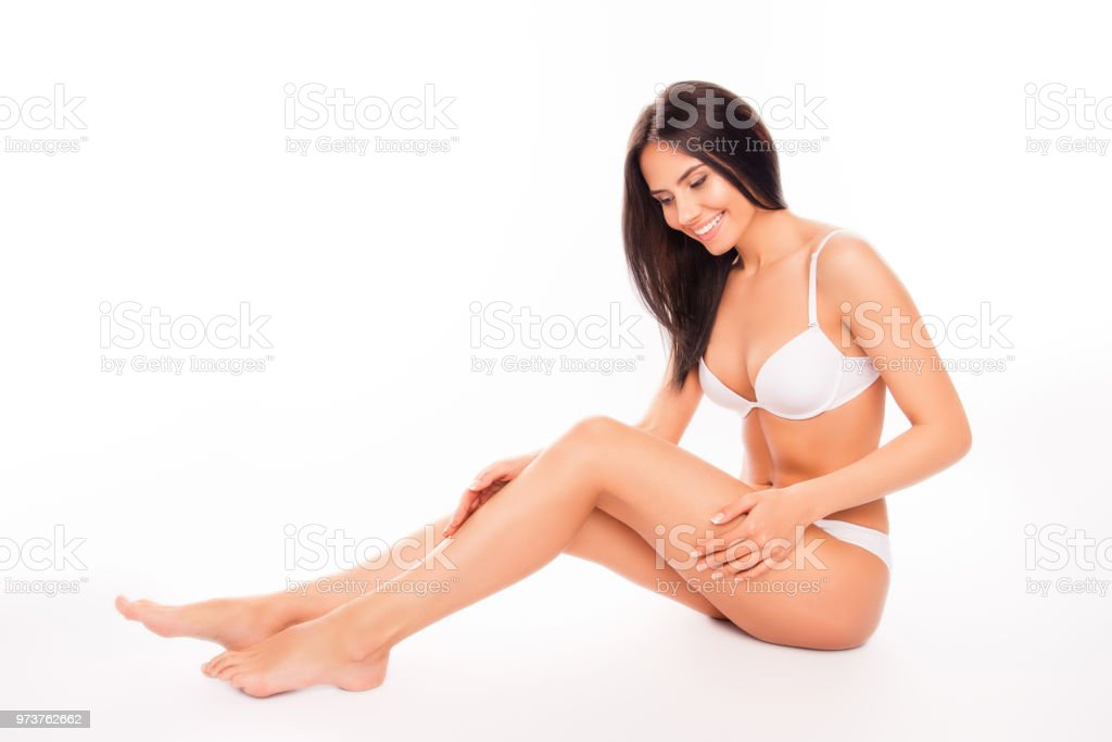 Beautiful Sensual Woman In White Underwear Doing Massage For Her Legs Stock Image
