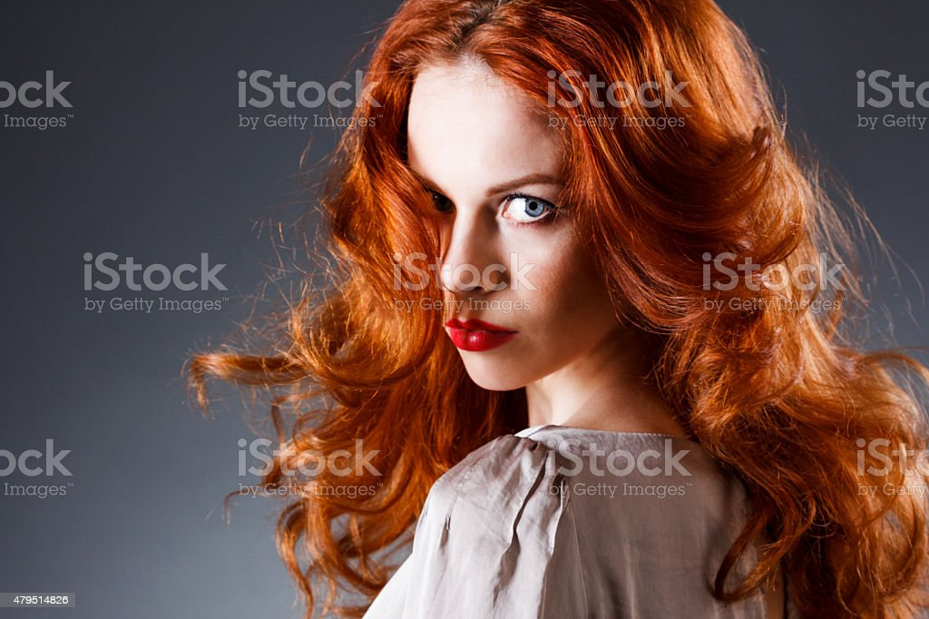 Beautiful sensual woman with long red hairs stock photo