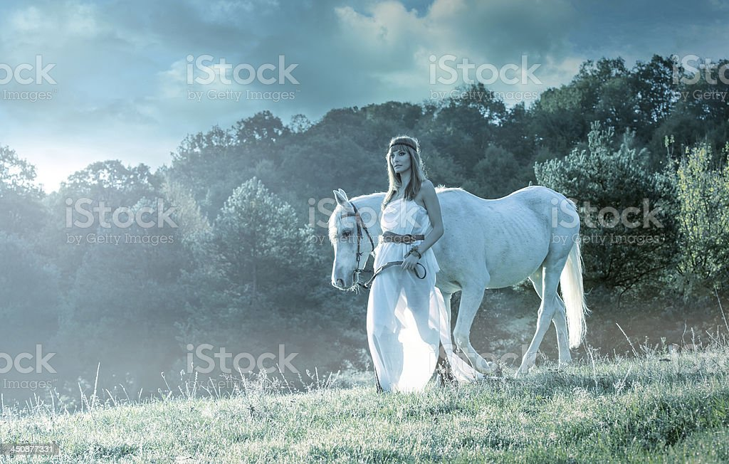 Beautiful sensual women with white horse royalty-free stock photo