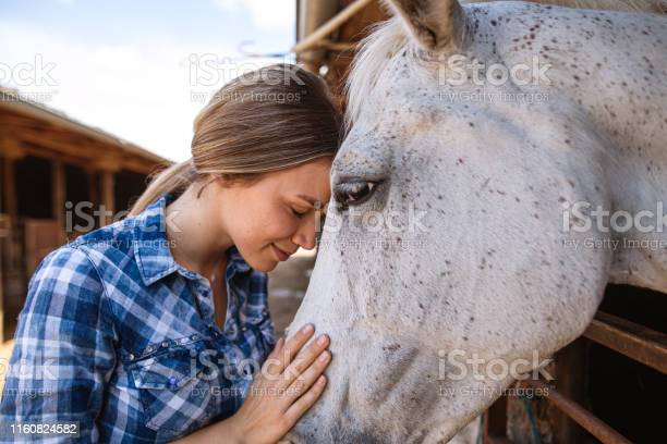 Beautiful serene girl spending a tranquil moment with a horse picture id1160824582?b=1&k=6&m=1160824582&s=612x612&h=rgidhinyrb8pvqm20m ws5wce34gn8ejezc9a0j0oro=