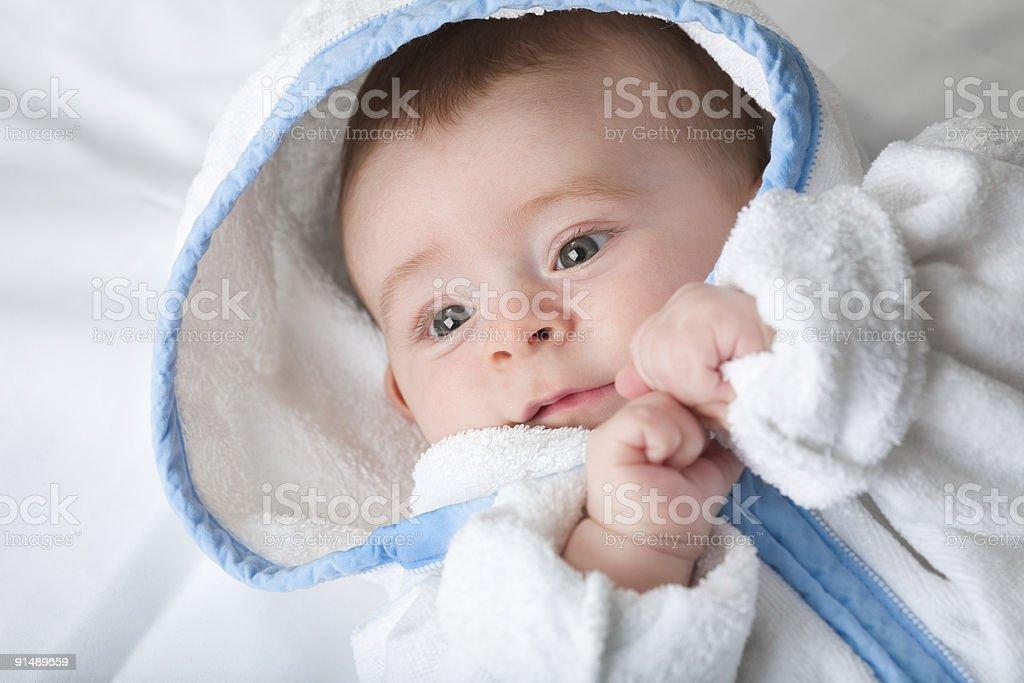 beautiful serene little baby in white robe royalty-free stock photo