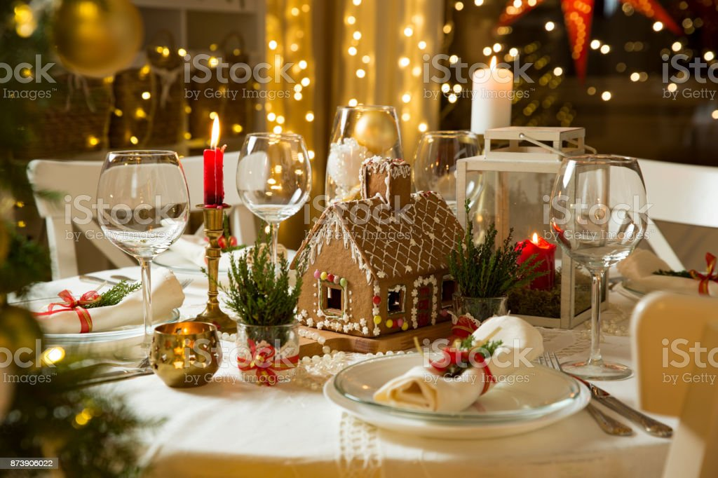 Beautiful served table with Christmas decorations, candles and lanterns stock photo