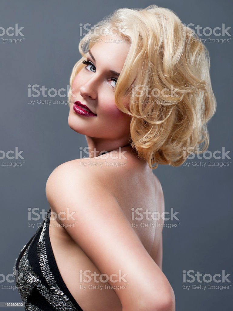 Beautiful, Sexy Blond Young Woman Portrait in Backless Gown stock photo