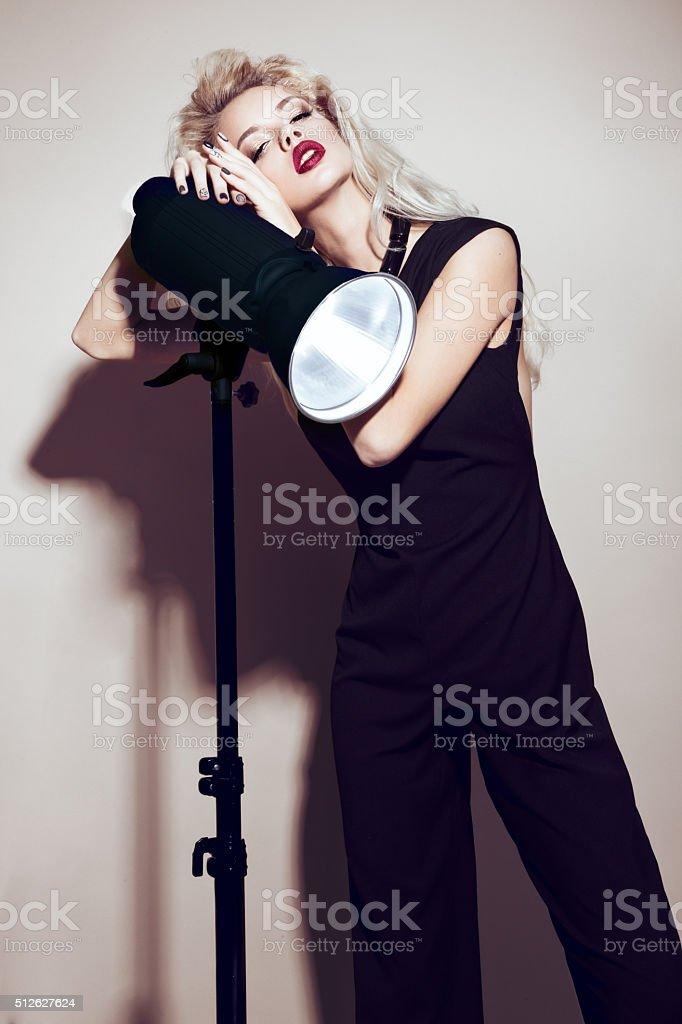 Beautiful sexy blonde girl with sensual lips, fashion hair stock photo