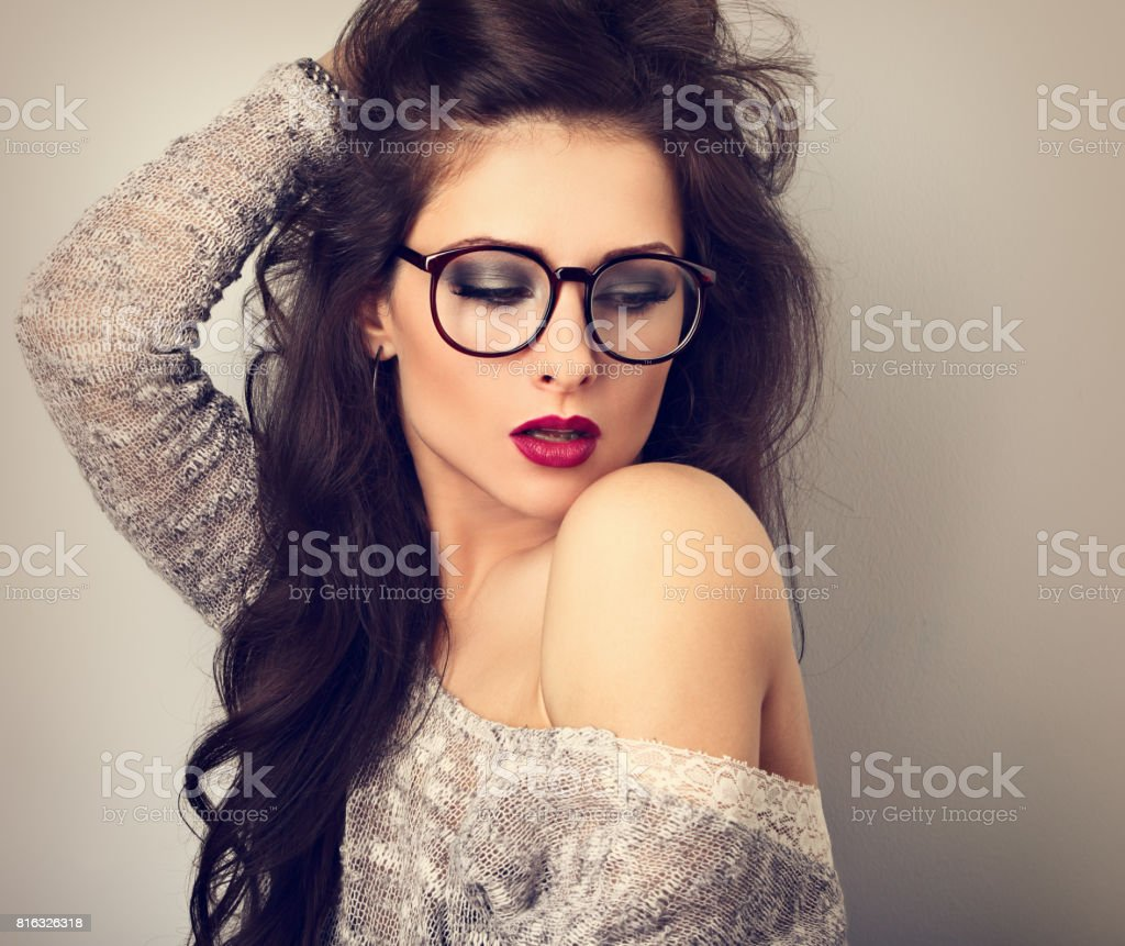 Beautiful Sexy Bright Red Lips Makeup Woman In Fashion Glasses Looking Down And Posing In Grey