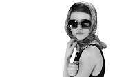 beautiful brunette woman in a retro style with sunglasses. black and white photo