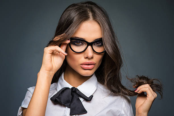 Beautiful sexy brunette young business woman wearing diopter glasses stock photo