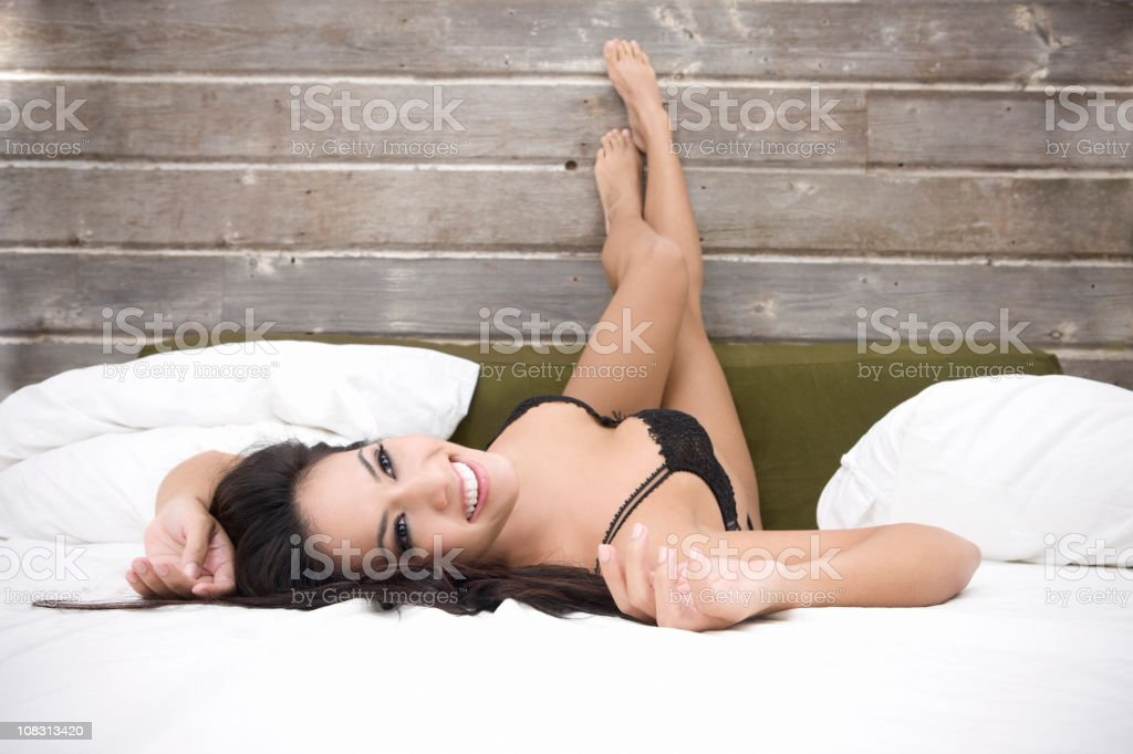 Beautiful Sexy Brunette Young Woman in Lingerie on Bed, Copyspace stock photo