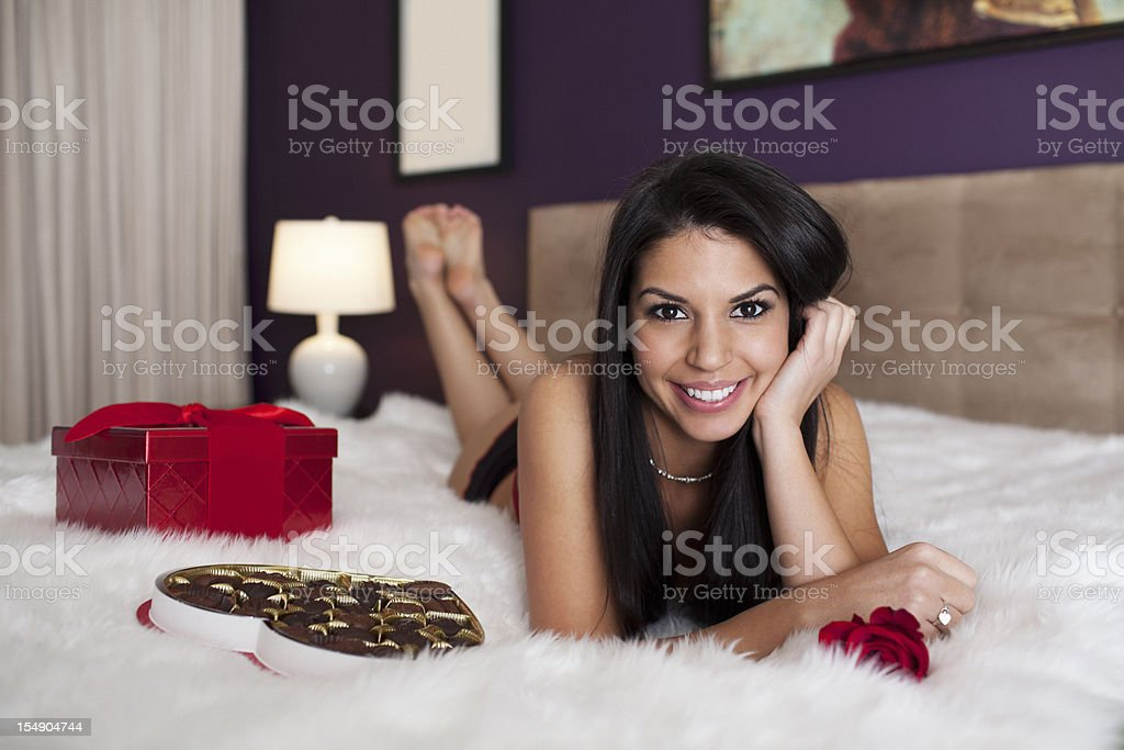 Beautiful, Sexy Brunette Young Woman in Lingerie with Valentines Gifts royalty-free stock photo