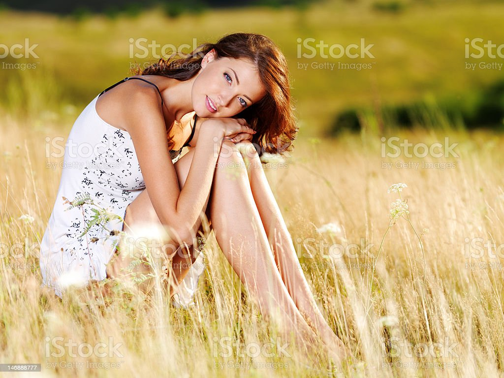 Beautiful  sexy caucasian woman on  meadow stock photo