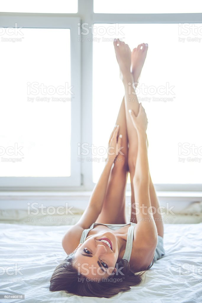 Beautiful sexy girl in bed stock photo