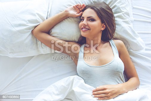 607490114istockphoto Beautiful sexy girl in bed 607493850