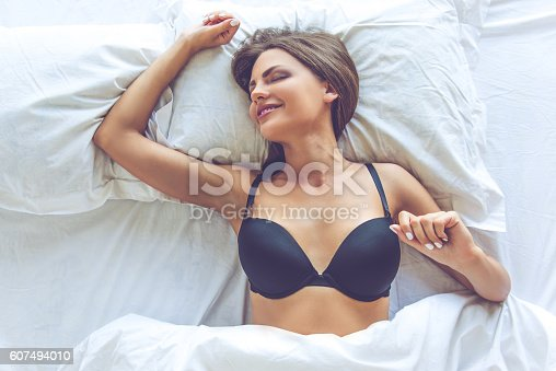 607490114istockphoto Beautiful sexy girl in bed 607494010