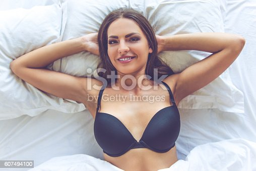 607490114istockphoto Beautiful sexy girl in bed 607494100