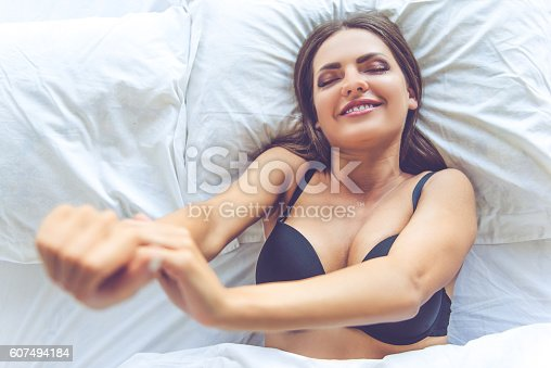 607490114istockphoto Beautiful sexy girl in bed 607494184