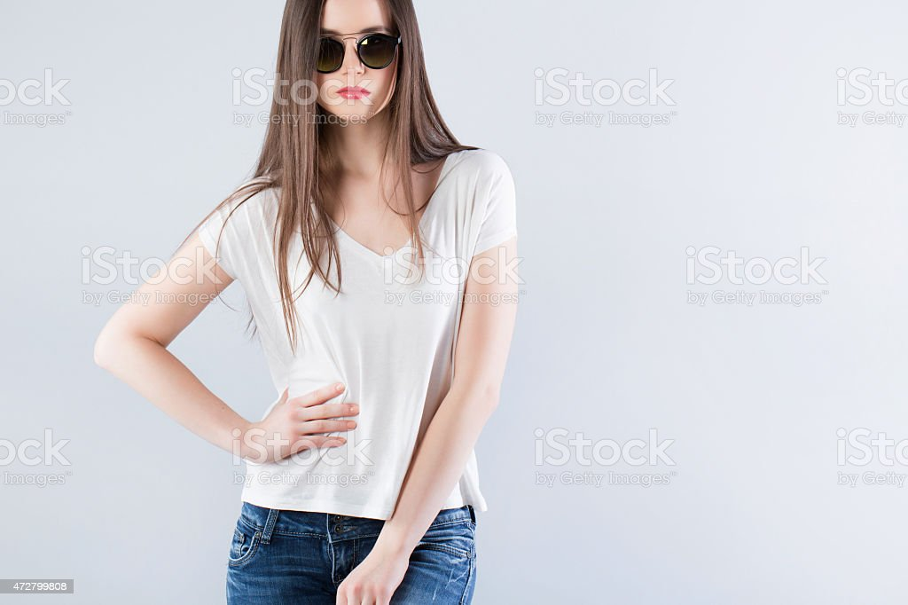 Beautiful sexy girl in jeans and a T-shirt stock photo