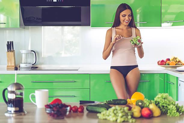 beautiful sexy girl in the kitchen - schmaler tisch stock-fotos und bilder