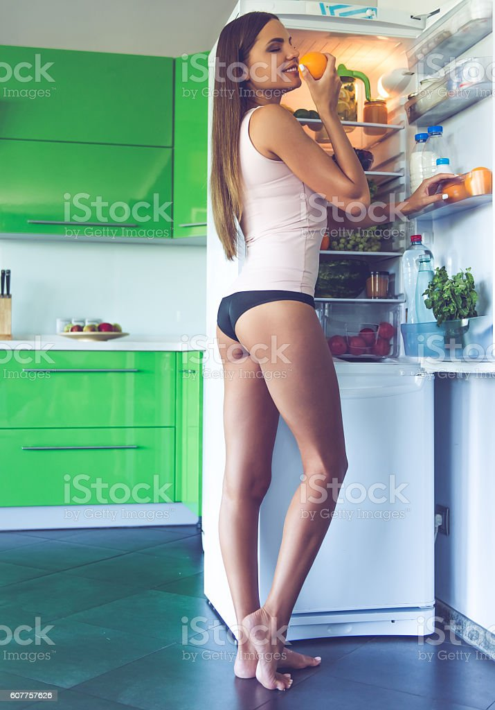 Beautiful sexy girl in the kitchen stock photo
