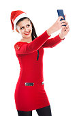 istock Beautiful Sexy Girl Wearing Santa Clothes Taking a Selfie 526725669