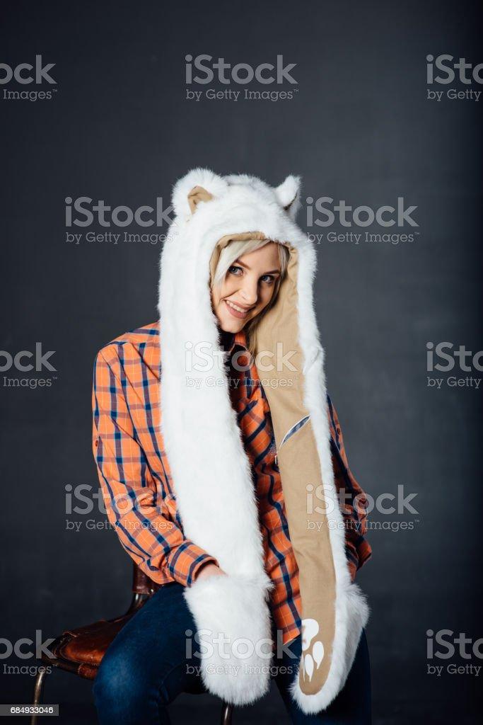 beautiful sexy girl wearing white fur hat stock photo