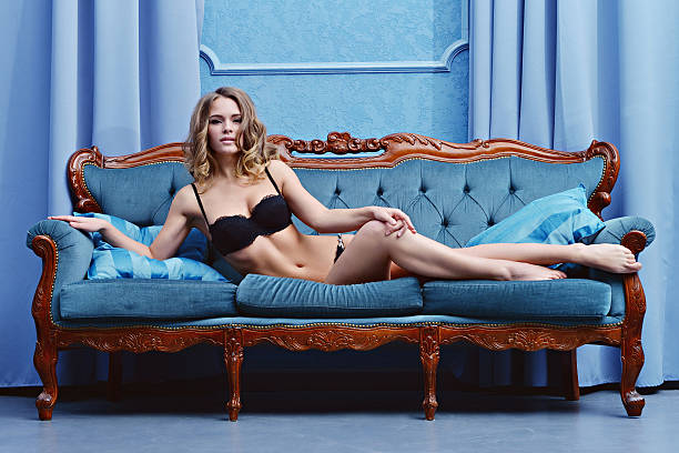 Beautiful sexy lady in elegant black panties and bra stock photo