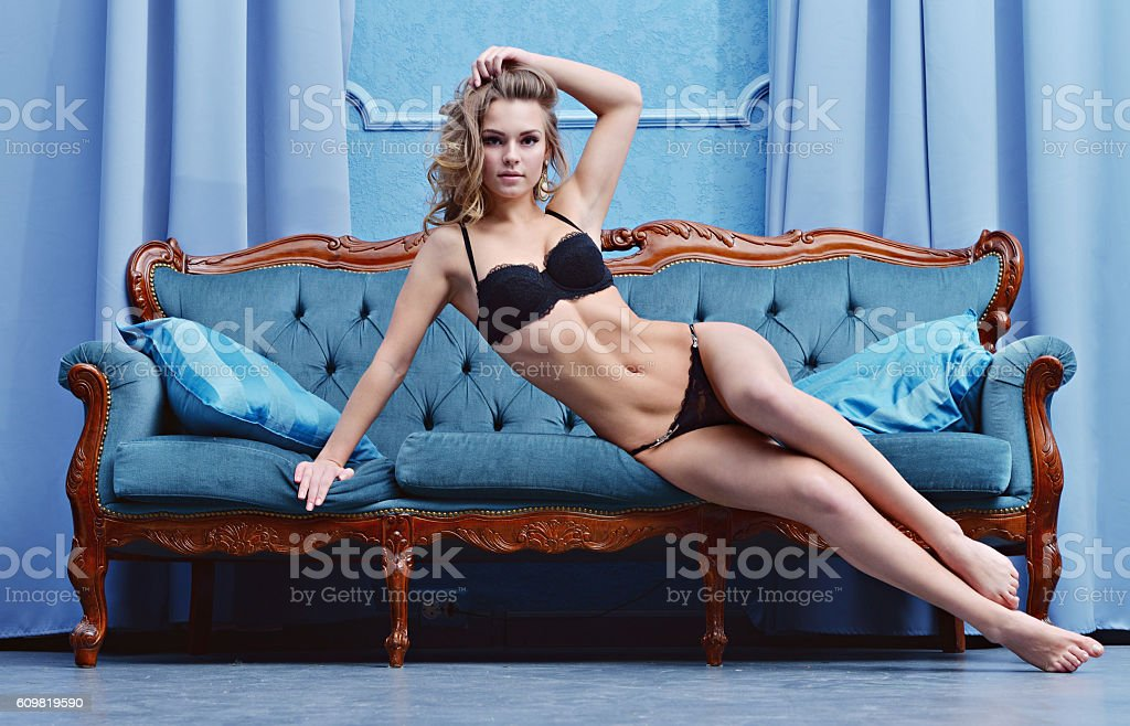 Beautiful sexy lady in elegant black panties and bra stock photo