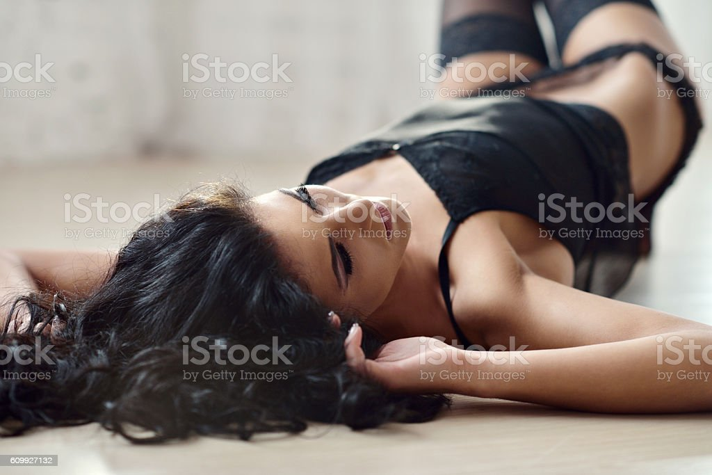 Beautiful sexy lady in elegant black panties and stockings stock photo