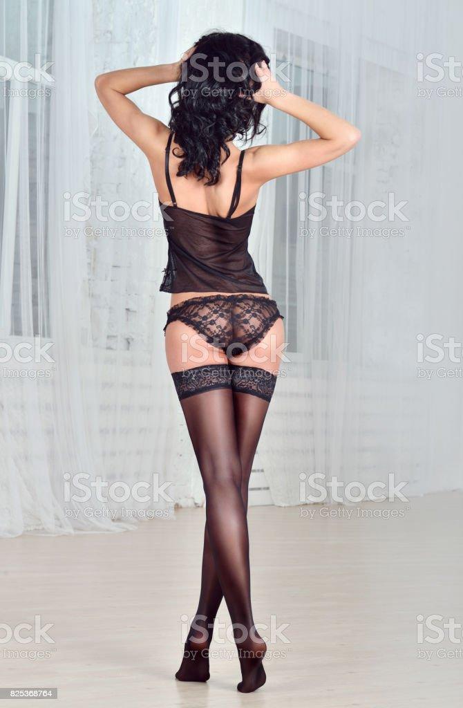 Beautiful sexy lady in elegant black panties and stockings стоковое фото
