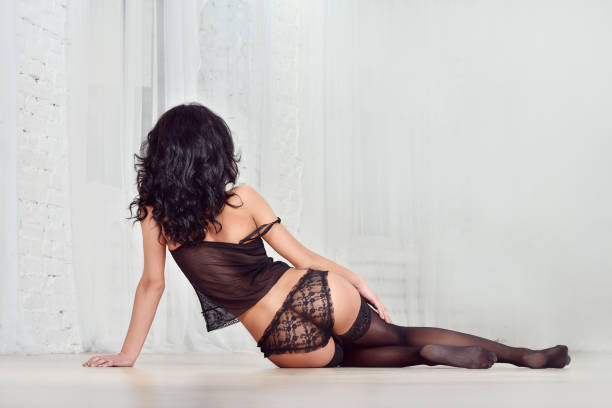 Cтоковое фото Beautiful sexy lady in elegant black panties and stockings