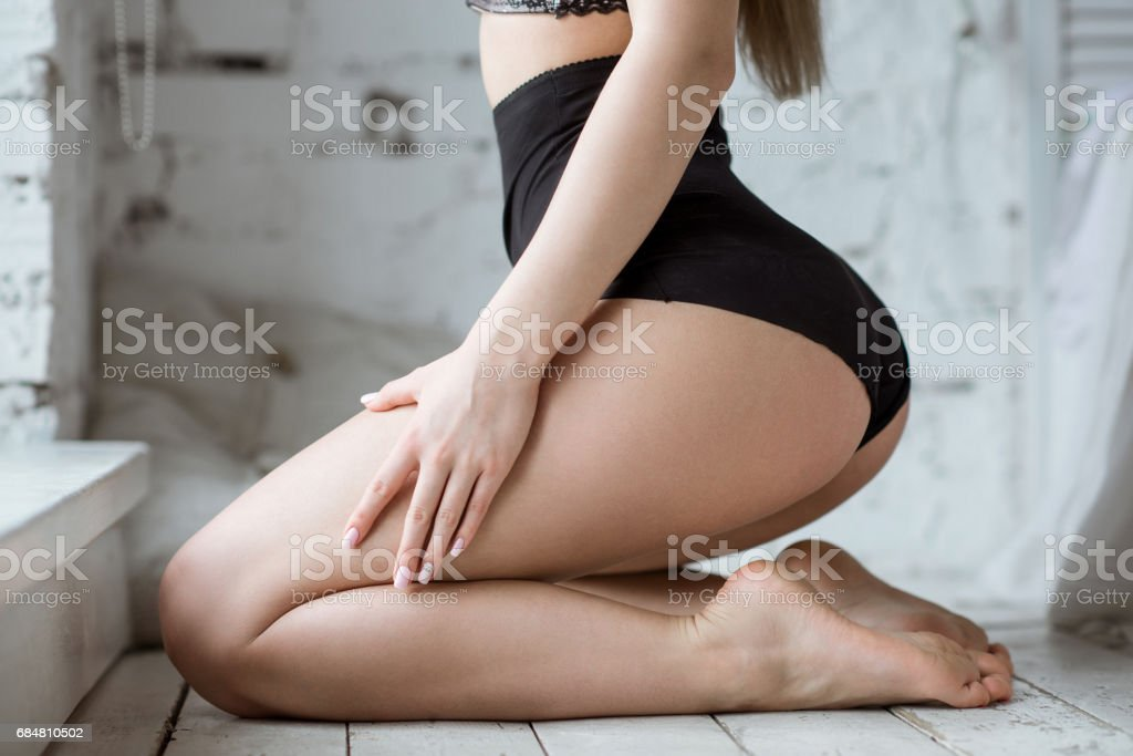 Beautiful sexy lady in elegant black panties stock photo