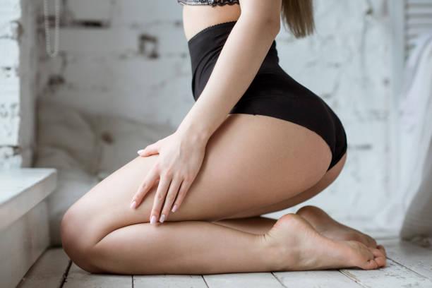 Beautiful sexy lady in elegant black panties stock photo