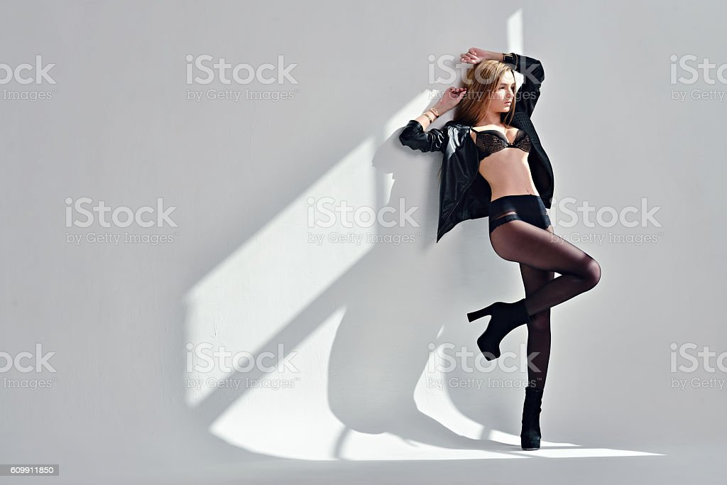 Beautiful sexy lady in elegant tights and bra stock photo