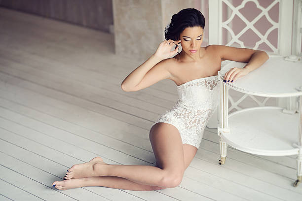 beautiful sexy lady in elegant white bodysuit - naked women with animals stock photos and pictures