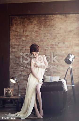 istock Beautiful sexy lady in elegant white dress 517514532
