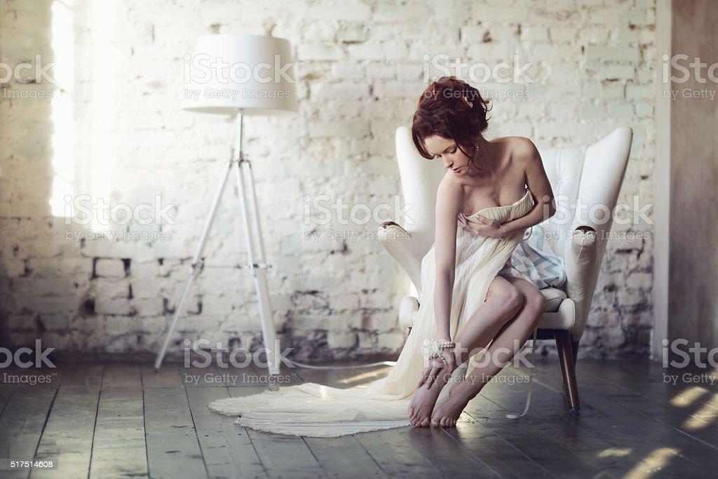 Beautiful sexy lady in elegant white dress stock photo