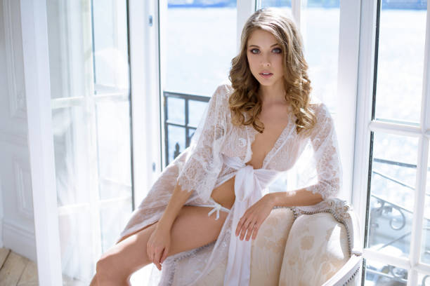 Cтоковое фото Beautiful sexy lady in elegant white robe