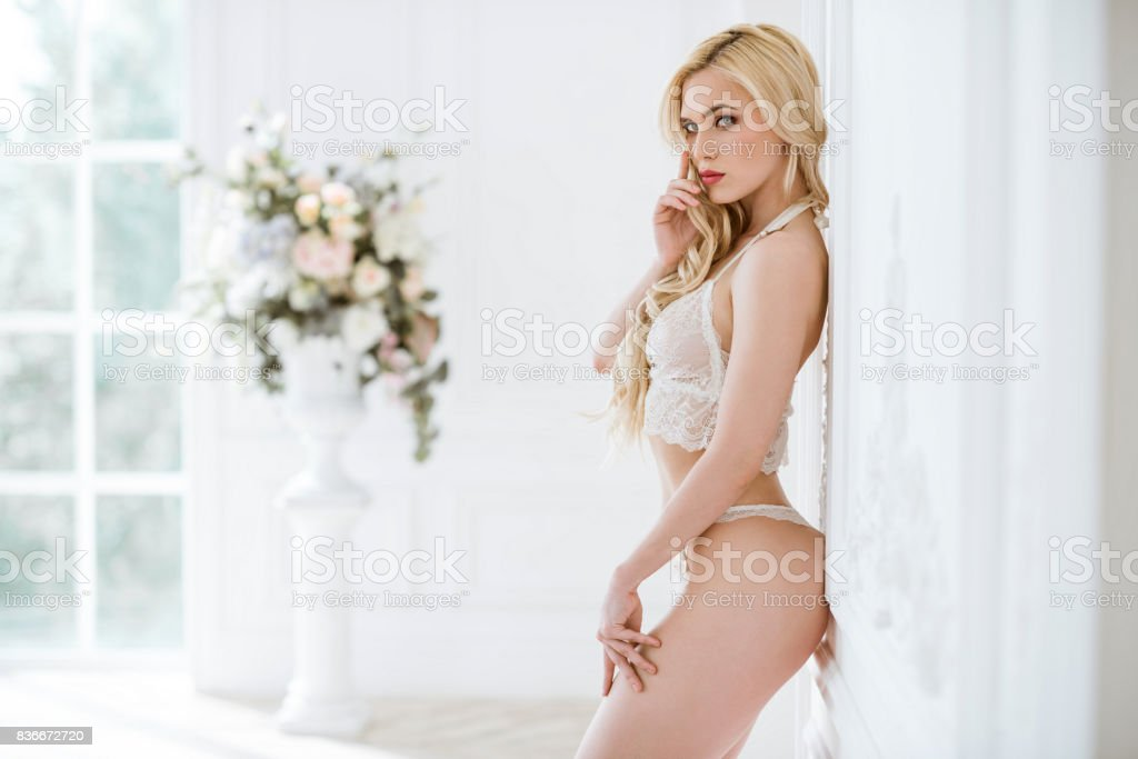 Beautiful sexy lady in white panties and bra стоковое фото