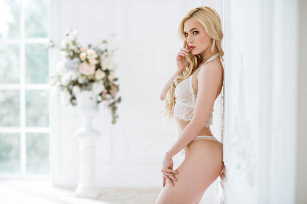 Beautiful sexy lady in white panties and bra stock photo
