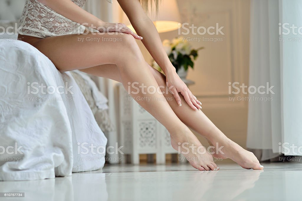 Beautiful sexy lady with elegant legs and hands stock photo