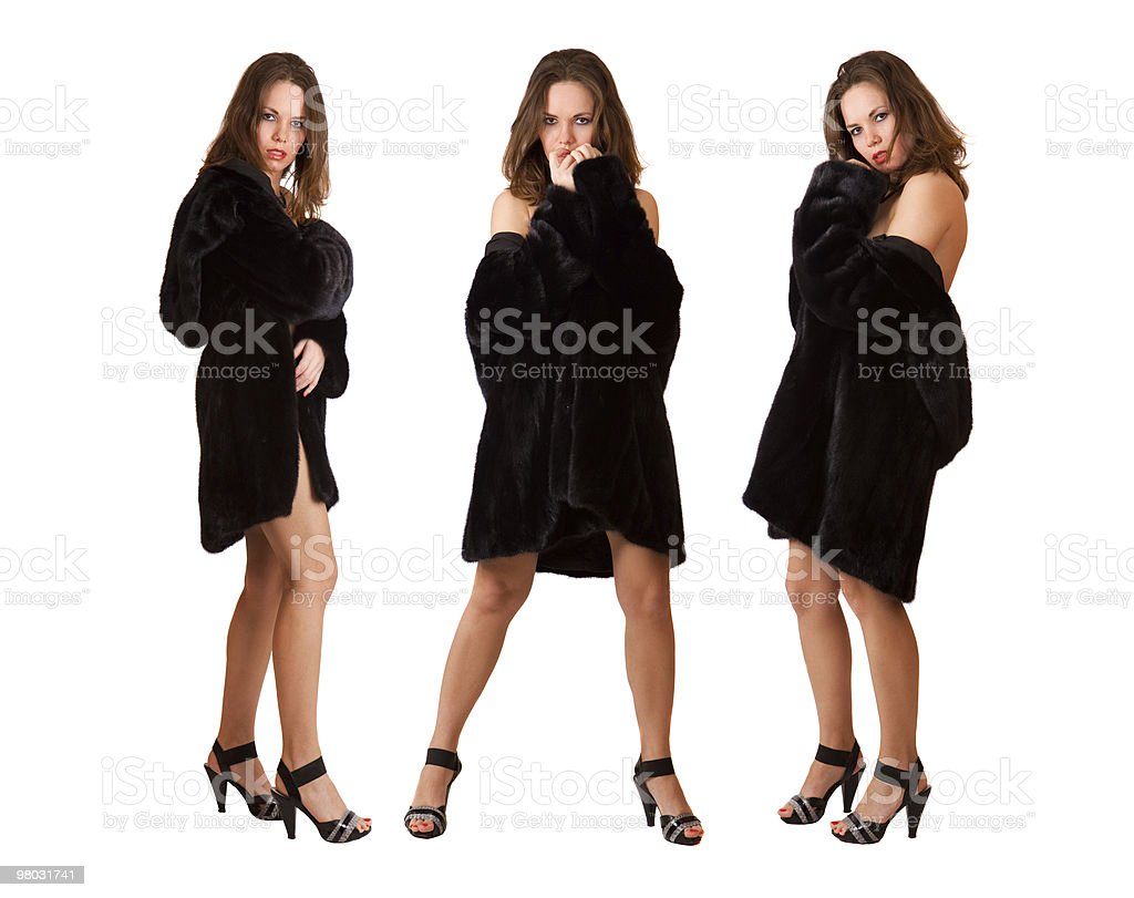 Beautiful sexy triplets girls in fur coat isolated royalty-free stock photo