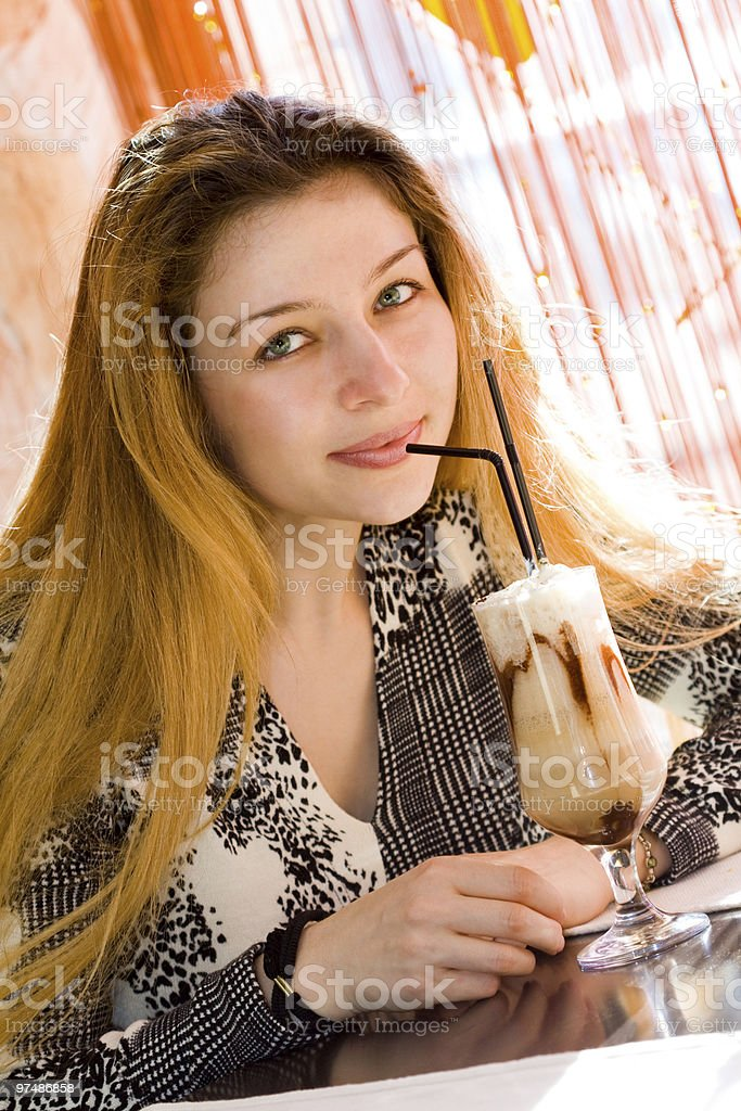 Beautiful sexy woman drinking latte coffee royalty-free stock photo