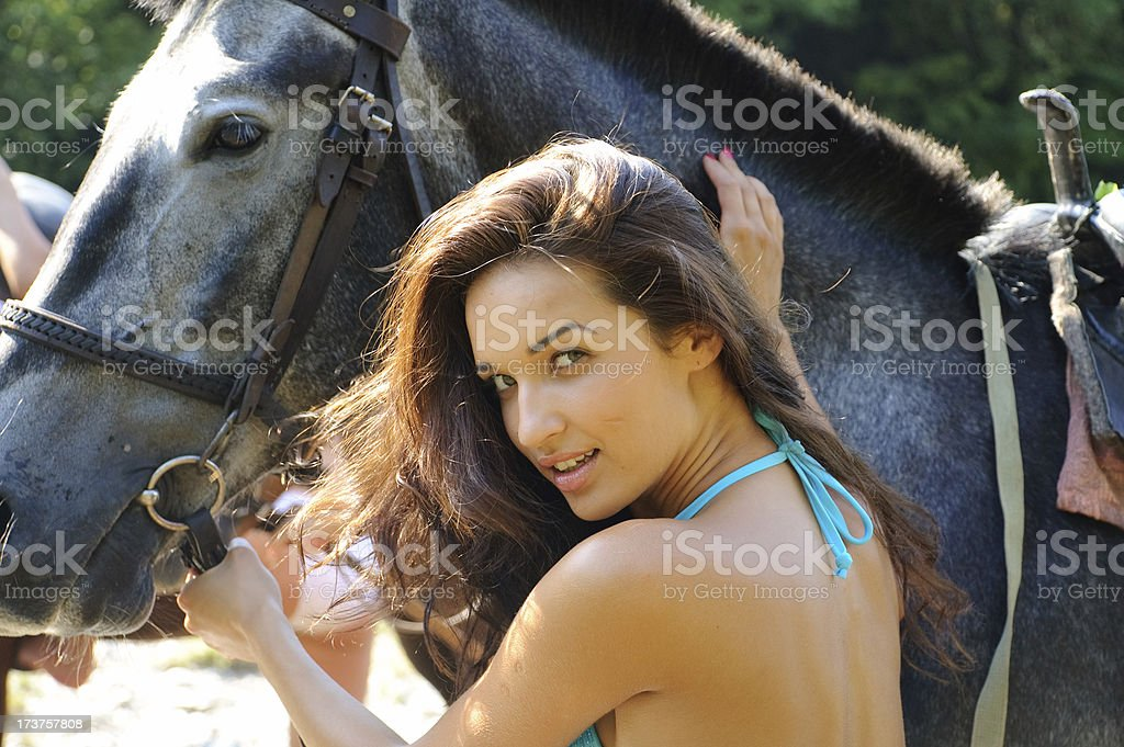 beautiful sexy woman holds the horse on nature royalty-free stock photo