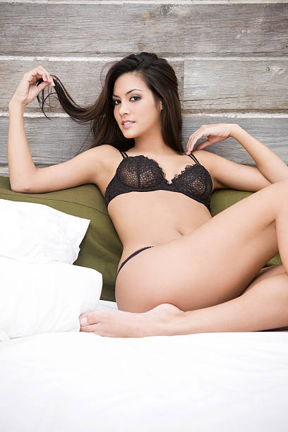 beautiful sexy woman in black lingerie at loft bed, copyspace - hawaiian ethnicity stock photos and pictures